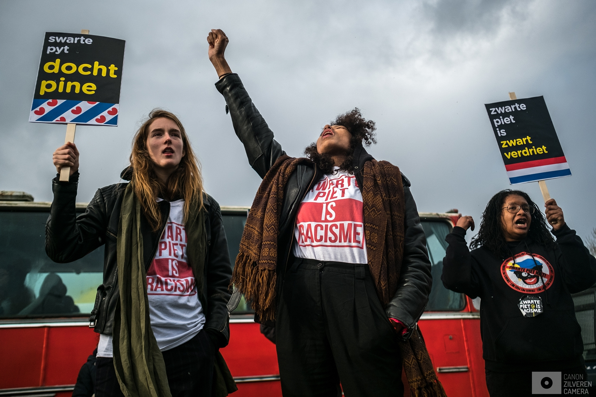OUDEHASKE | A couple of Anti Black-Pete activists are shouting slogans while waiting during a break at a gas station while being escorted back to Amsterdam.  | #11
