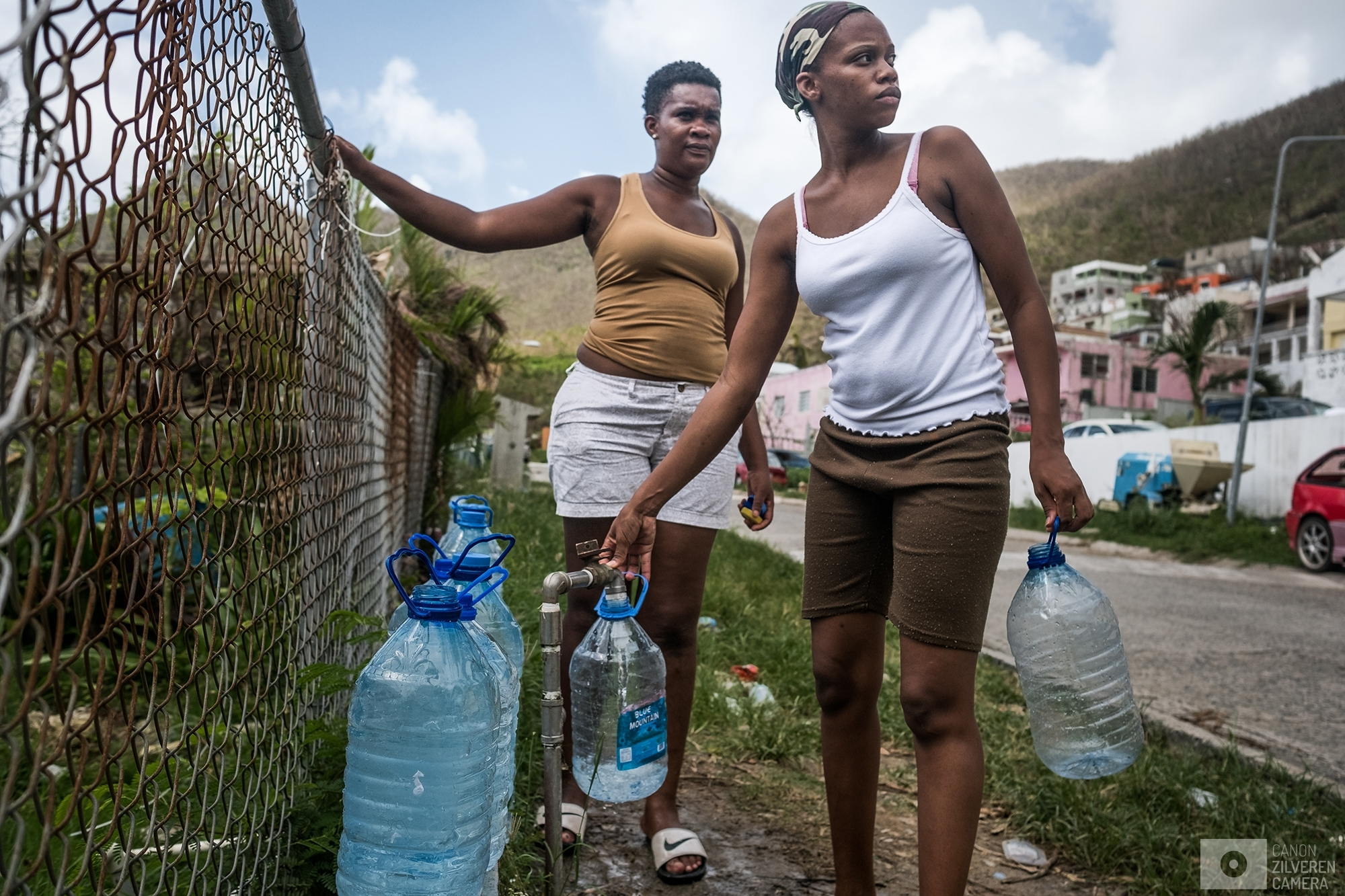 SINT MAARTEN | Two women are collecting water from a local tap. Many houses are without electricity or running water. | #9