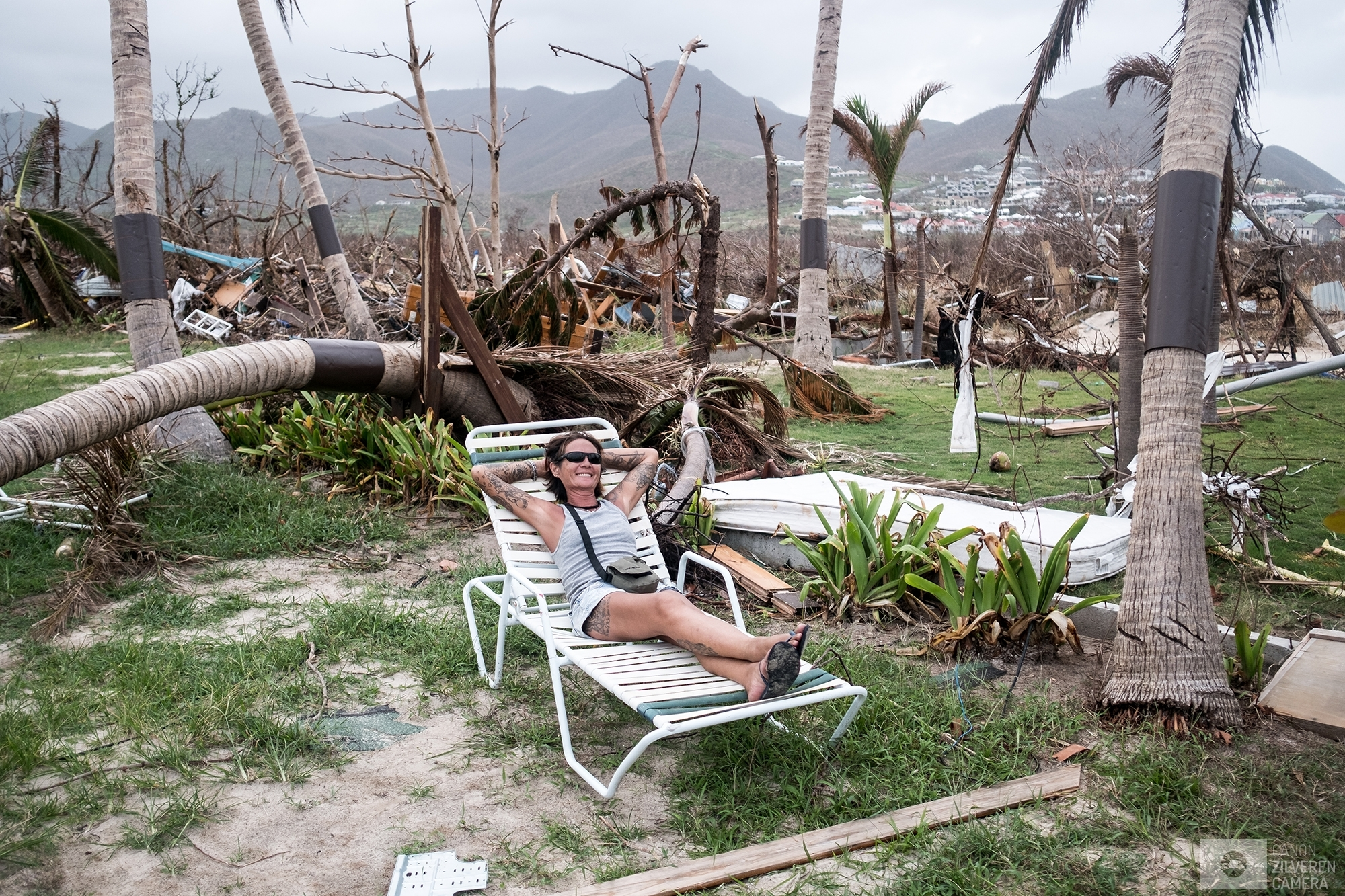 SINT MAARTEN | A woman is taking a rest while scavaging a former nudist beach, now totally in ruins, for usefull parts to repair her house. | #2