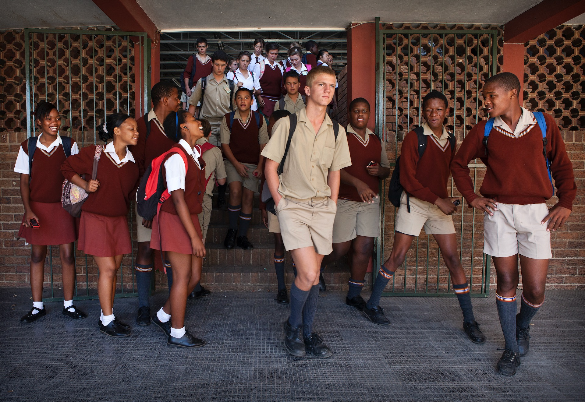 1. Students of Tom Naudé High School in Polokwane, walking from one classroom to the other in between classes. (2012)   In 1994, 25 years ago, Nelson Mandela became South Africa's first black president and his nation a free country. The segregation system of apartheid ended. Mandela had high hopes for the youth, the children born in the years right after apartheid ended are now young adults: the born-free generation for whom racial segregation is a thing of the past. They were to be the face of a new, free and successful South Africa. My personal project, ranging over 12 years, takes a look into how free the born-frees really are and how modern day racism influences their day-to-day lives.