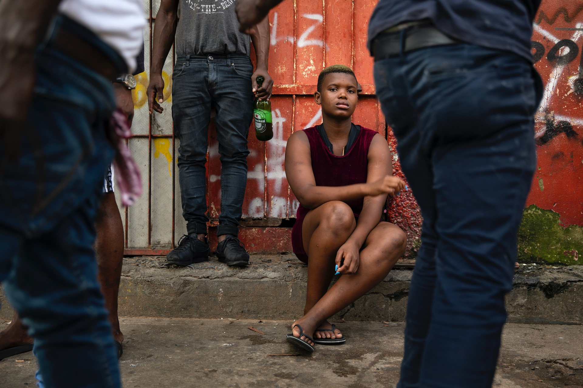 "2. Homeless Nonjabulo Ndzanibe (21) sits on the side walk on one of the rough areas of Durban, South Africa. To find shelter, she sometimes sleeps with men for money. (2018)  ""I wanted to get that fresh air,"" Nonjabulo Ndzanibe (21) explains why she ran away from her unhappy childhood home to the coastal city of Durban. ""I just needed space for myself."""